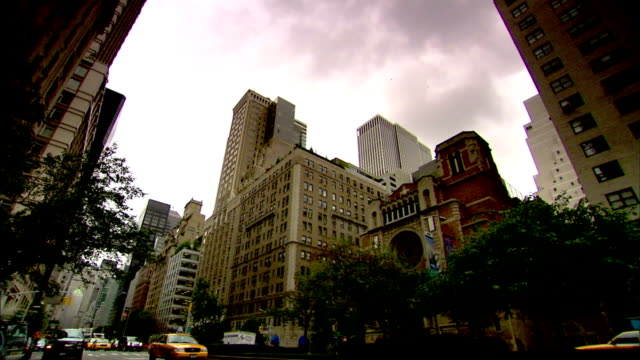 angled park avenue w/ traffic, many taxi cabs, taxis, moving south through frame, downtown, christ church across street behind median trees. upscale... - median nerve stock videos & royalty-free footage