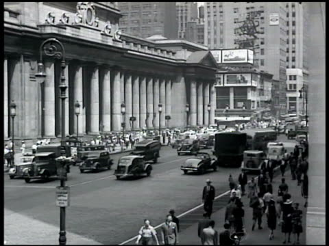 angled ws penn station w/ eight avenue traffic people walking fg 1936 int penn station open room ms people walking from train tu ls manhattan offices... - new york city penn station stock videos and b-roll footage