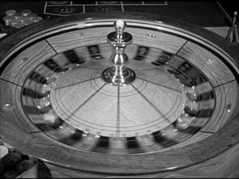 angled people placing bets on roulette table w/ stacks of chips & wheel fg, roulette wheel spinning counterclockwise, male croupier hand rolling ball... - croupier stock videos & royalty-free footage