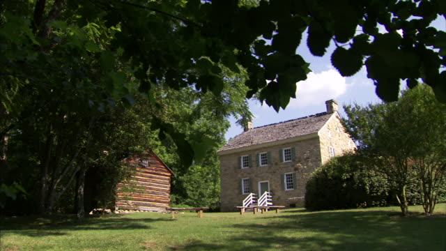 hd *angled ws reconstructed wooden kitchen building two story stone home no people national register of historic places american revolution colonial - american revolution stock videos & royalty-free footage
