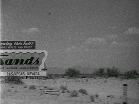 sign angled ws passing desert amp scrub plants large billboard advertising 'opening this fall nevada's newest and finest a place in the sun sands... - 1952 stock videos and b-roll footage