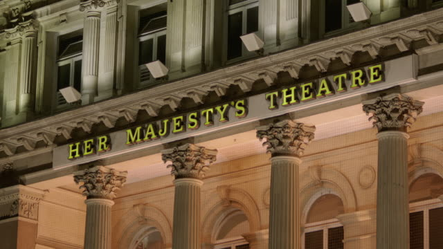 angled shot of her majesty's theatre in london's west end uk fkaa355a clip taken from programme rushes abmb140l - text bildbanksvideor och videomaterial från bakom kulisserna