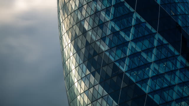 angled shot of the gherkin, london - timelapse - swiss re stock videos & royalty-free footage