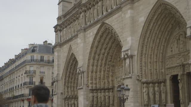 Angled shot of the three portals on the west facade of Notre Dame de Paris, France.