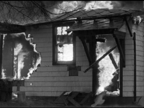 angled ms single story wood frame house on fire in rain window front wall burned support beams inside home flaming strong flames inside by front door... - burnt stock videos & royalty-free footage