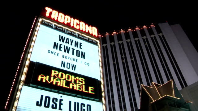angled slight reverse lighted neon tropicana marquee wayne newton once before i go w/ hotel & casino building bg. celebrating 50 years on the strip,... - wayne newton stock videos & royalty-free footage