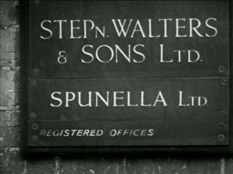 angled ms stephen walters building sign 'stepn walters sons ltd spunella ltd' gwen curtis in dust free glass room working on loom weaving royal robes... - 1953 stock videos and b-roll footage