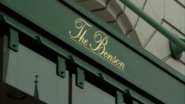 angled ws zi ms 'the benson' understated sign painted lettering on front of awning elegant upscale national register of historic places landmark - awning stock videos and b-roll footage