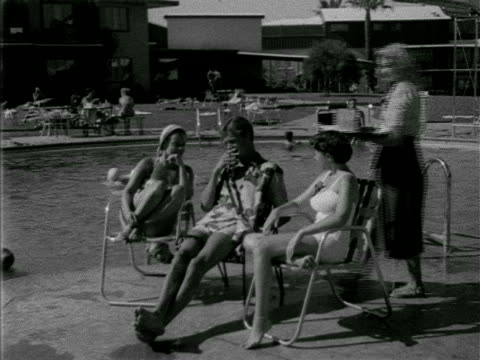 angled ws three young adults sitting in chairs by pool waitress bringing iced beverages in tall glasses people sitting at edge of water amp at tables... - tall high stock videos & royalty-free footage