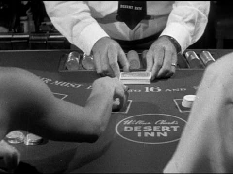 angled ws two females male sitting at table w/ male dealer standing vs shuffling cards female cutting dealer dealing players asking for cards dealer... - shuffling stock videos and b-roll footage