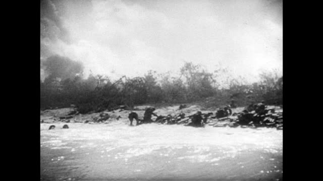 angled ws us soldiers on shore w/ vegetation bg vs soldiers wading ashore from landing ships walking chest deep water wading waist high behind... - waist deep in water stock videos & royalty-free footage