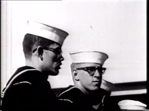 angled ws uss enterprise sailors standing in line on deck zi two sailors ha ws dock ship moving away officer sot calling directions others repeating... - marina personale militare video stock e b–roll
