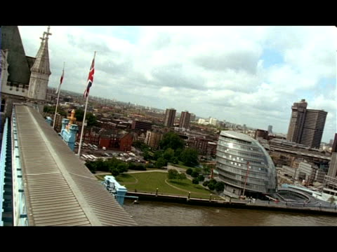 wa angled view from top of tower bridge to city hall, london, england - gla building stock videos & royalty-free footage