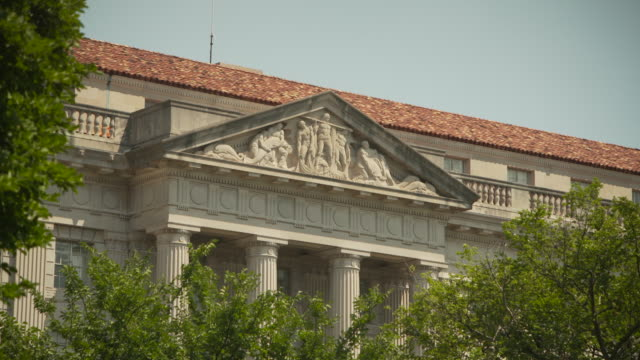 Angled view of a frieze on the Herbert C. Hoover building in Washington, D.C., USA.