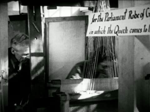 angled warner & sons building, hilda calver weaving on hand loom, j.w. beard watching, sign '...robe of crimson...', vs hilda weaving, sign '...robe... - ベルベット点の映像素材/bロール