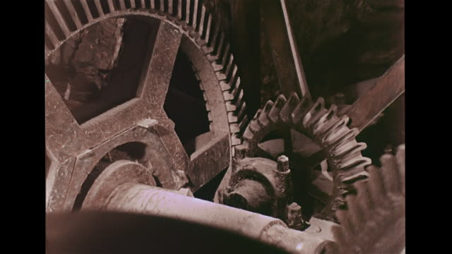 HA Angled WS Waterwheel outside building VS Flowing water turning wheel VS Axles gears grindstone turning male adding corn into dried corn into...