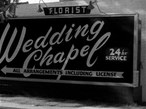 Angled MS 'Wedding Chapel' sign w/ no name Angled MS 'Gretna Green Marriage Place All Arrangements including license flowers music immediately'