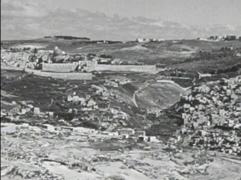 angled xws city of jerusalem walls xha ws jerusalem w/ masjid qubbat assakhrah prominate beyond wall vegetation trees below fg - 1946 stock videos and b-roll footage