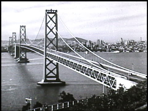 angled ws bay bridge w/ city bg angled ws union square w/ dewey monument cars going into out of tunnels ws wells fargo bank angled ms san francisco... - pacific city stock videos & royalty-free footage