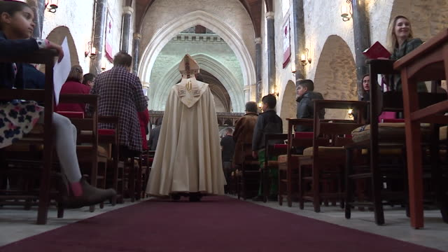 Anglican Archbishop in Jerusalem Suheil Dawani holding Christmas Day service