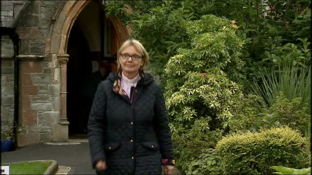 anglican church elects first woman bishop; northern ireland: derry / londonderry: ext reverend pat storey towards from church int pat storey and... - anglican stock videos & royalty-free footage