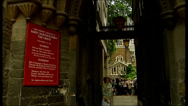 anglican clergymen have civil partnership blessed in church; england: london: ext sign 'the priory church of saint bartholomew the great' visitors... - anglican stock videos & royalty-free footage