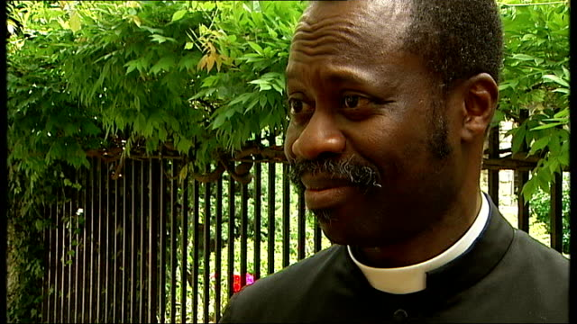 anglican clergymen have civil partnership blessed in church; ext father christopher oladuji interview sot - saying he wasn't aware until he heard it... - anglican stock videos & royalty-free footage