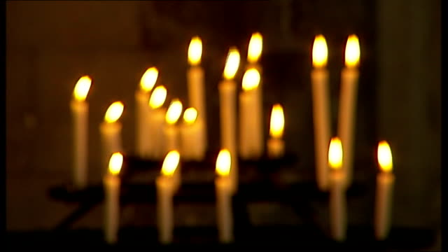 anglican clergymen have civil partnership blessed in church; int pull focus candles burning in church - anglican stock videos & royalty-free footage