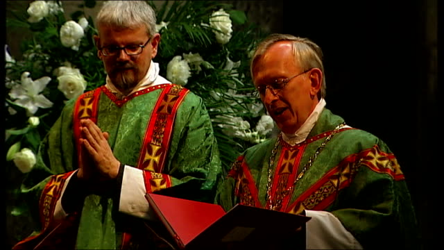 anglican clergymen have civil partnership blessed in church int rev dudley conducting church service - anglican stock videos & royalty-free footage