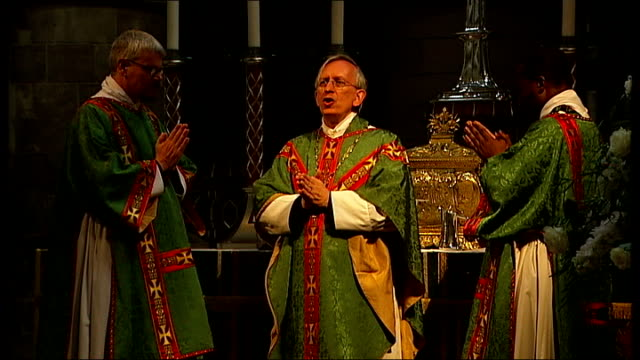 anglican clergymen have civil partnership blessed in church; int reverend dudley conducting church service - anglican stock videos & royalty-free footage