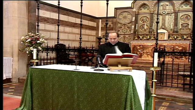 anglican vicar jailed for child abuse; date unknown int **anonymous victim interview overlaid sot** smith looking at prayer book at altar and... - anglican stock videos & royalty-free footage