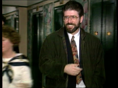 new york cms gerry adams along corridor as handed something by woman shakes man cms adams taking a drink as being miked up for interview cms adams... - gerry adams stock videos and b-roll footage