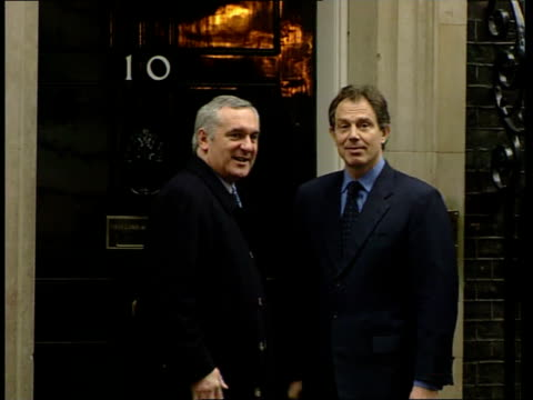 bertie ahern and tony blair discuss the 'good friday agreement' itn england london downing street irish pm bertie ahern shaking hands with british pm... - bertie ahern stock videos and b-roll footage