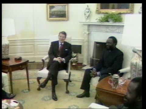 Washington White House TCMS Savimbi smiling TMS Ronald Reagan seated next Savimbi TX CMS Reagan talking ITN Mat Held in W'ton TMS Reagan Savimbi