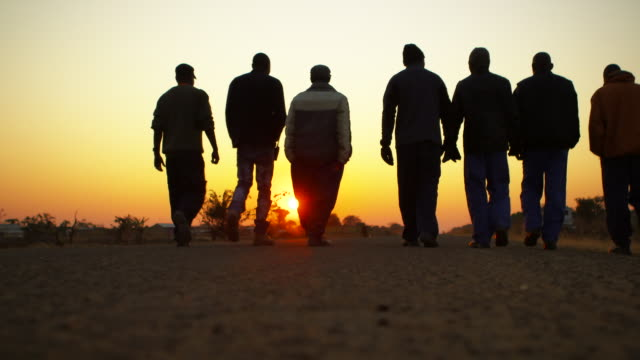 angolan mine sweepers walk on road at sunset - horizon stock videos & royalty-free footage
