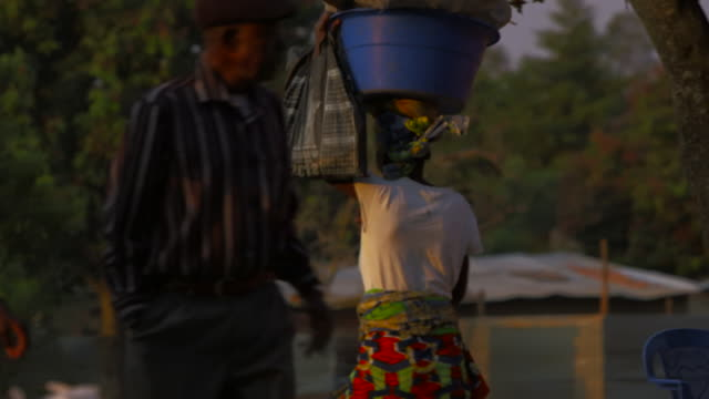 angolan woman carries basket on her head - basket stock videos & royalty-free footage