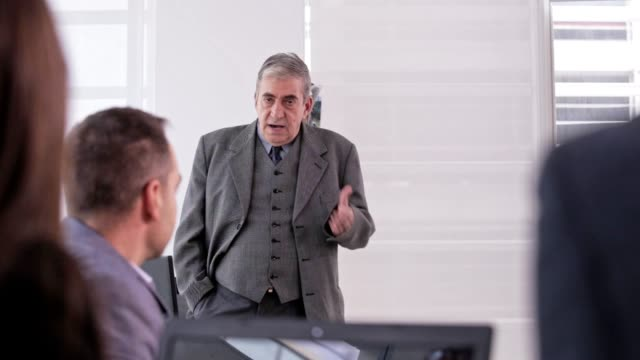 angry boss at a meeting - manager stock videos & royalty-free footage