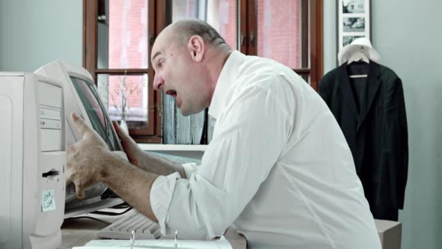 SLO MO Angry business man screaming at computer screen