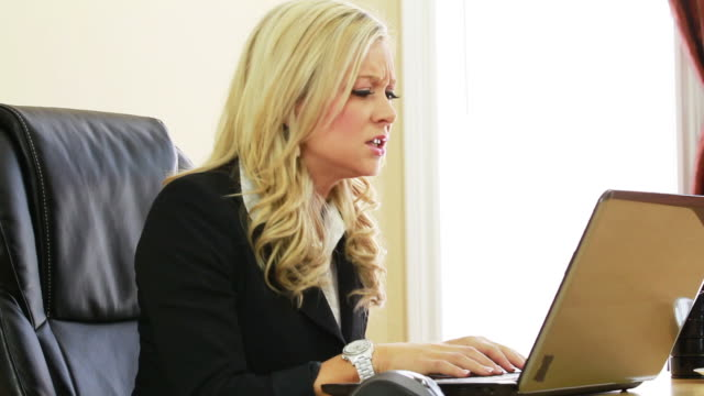 Angry business woman with laptop