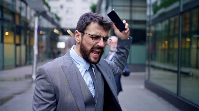 angry businessman arguing with senior ceo after he bumped into him - anger stock videos & royalty-free footage