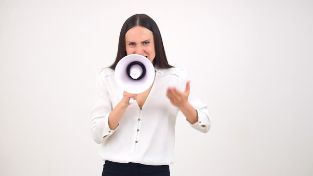 angry businesswoman talking through a megaphone - complaining stock videos & royalty-free footage