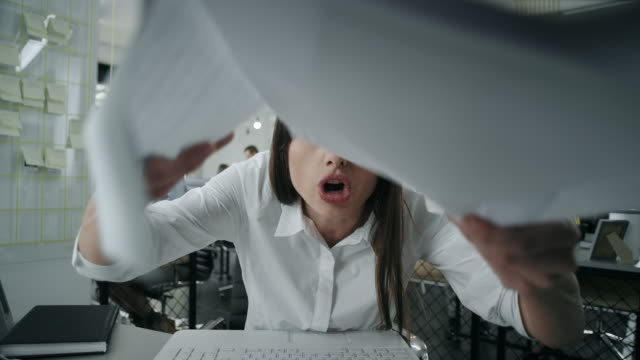 angry businesswoman throwing papers - displeased stock videos and b-roll footage