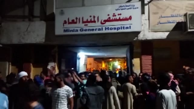angry coptic christians in mourning kept a vigil outside a hospital in central egypt overnight to receive the bodies of relatives killed in a gun... - violence stock videos & royalty-free footage