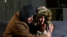 Angry couple freezing at home in a cold winter