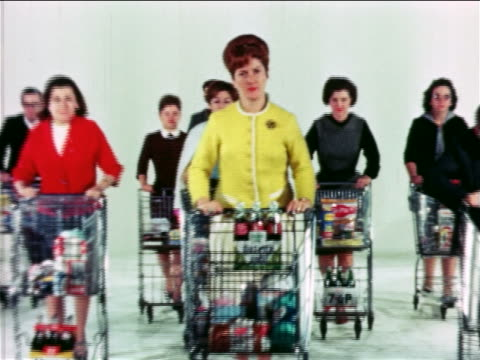 1965 angry crowd of people pushing shopping carts toward camera / educational - consumerism stock videos & royalty-free footage