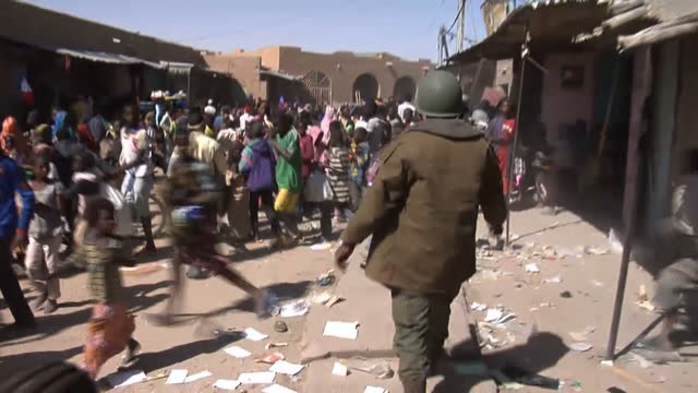 angry crowds have taken to the streets of timbuktu, plundering the homes and businesses of suspected jihadist supporters. it comes as mps back in the... - jihad stock videos & royalty-free footage