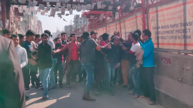 angry crowds in dhaka bangladesh attacking a reporter on the day of the general election - photography themes stock videos & royalty-free footage