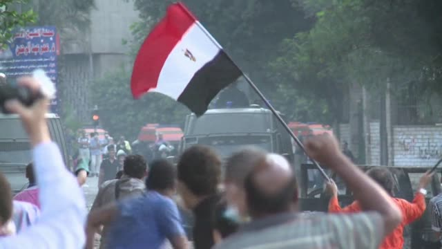 angry crowds protesting against a film deemed to mock the muslim prophet clashed with security outside the us embassy in the egyptian capital on... - demonstration stock videos & royalty-free footage