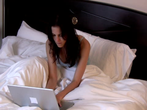 angry email.  wireless communication, work in bed - nightdress stock videos & royalty-free footage