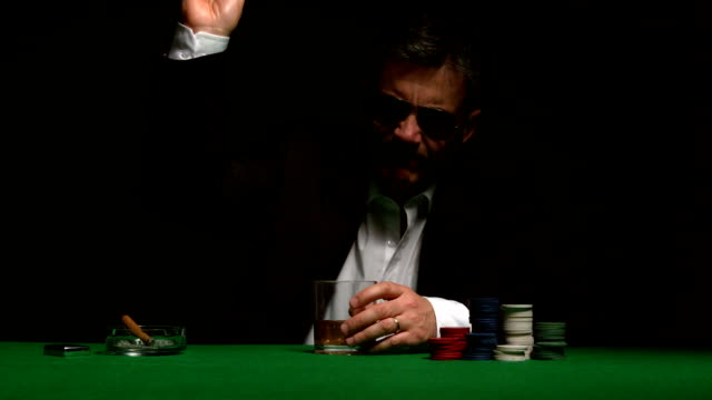 angry gambler folding his hand of poker - folded stock videos & royalty-free footage